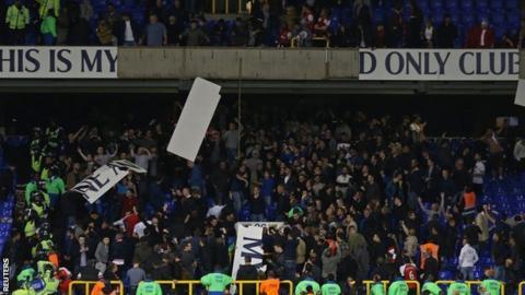 Fans tear down Tottenham banners