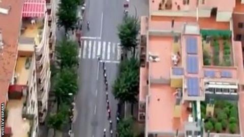 Helicopter Camera Following Cycling Race Uncovers Rooftop Marijuana Farm