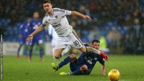 Tom Cairney of Fulham is tackled by Craig Bryson of Cardiff City