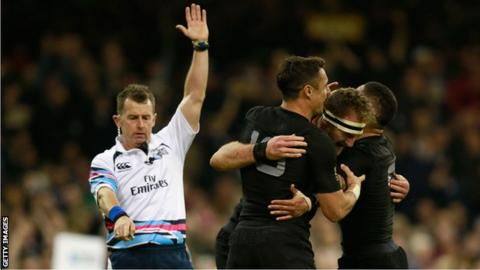 Nigel Owens awards a try during the New Zealand v France Rugby World Cup quarter-final