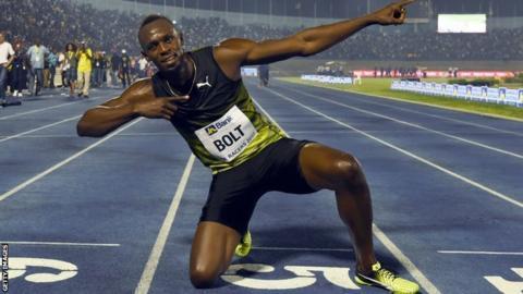 Usain Bolt celebrates on the track