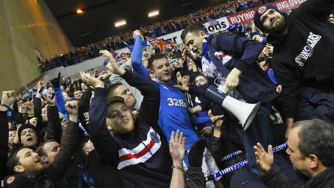 Andy Halliday celebrates with the Rangers fans