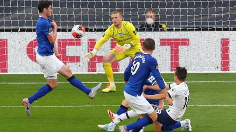 Michael Keane scores an own goal for Everton against Tottenham