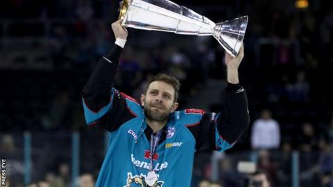 Patrick Dwyer celebrates with the Elite League trophy at the SSE Arena in April