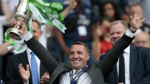 Brendan Rodgers holds aloft the Scottish Cup