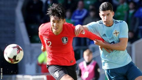 Lee Yong and Jordan Jones in action during Northern Ireland's 2-1 win over South Korea in March