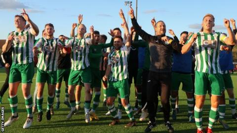 Chichester City players and staff celebrate beating Bowes & Pitsea in the fourth qualifying round of the FA Cup