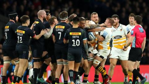 Harlequins and Wasps players clash