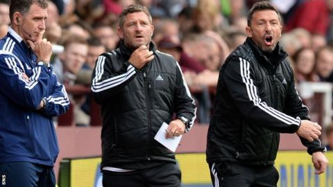 Assistant manager Tony Docherty and manager Derek McInnes shout instructions to the players