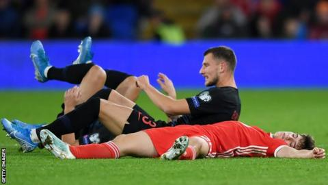 Wales winger Daniel James suffered a heavy collision with Domagoj Vida and Borna Barisic of Croatia