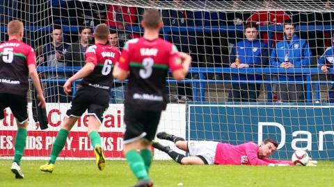 Glens keeper Elliott Morris makes a save but the Bannsiders went on to clinch a 1-0 victory