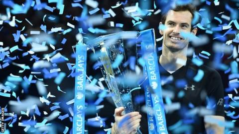 Andy Murray lifts the ATP World Tour Finals trophy