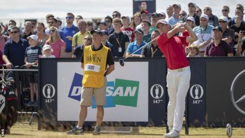 Scotland's Sam Locke tees off on the 18th at Carnoustie