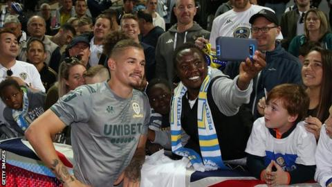 Kalvin Phillips poses for a photo with Leeds fans