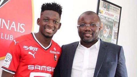 Mali international Hamari Traore (left) and his agent Bakary Sanogo