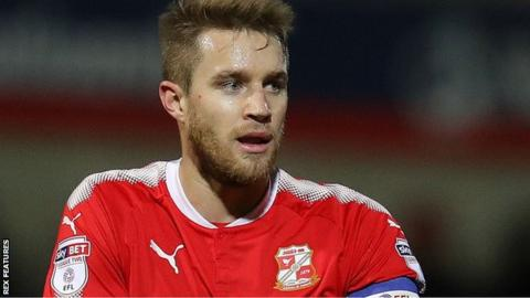 Olly Lancashire in action for Swindon