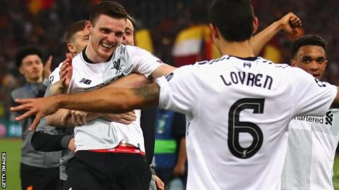 Andy Robertson celebrates as Liverpool reach the final of the Champions League