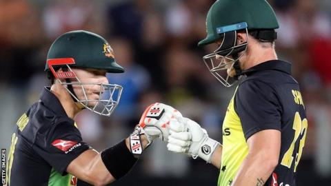 David Warner (left) and D'Arcy Short