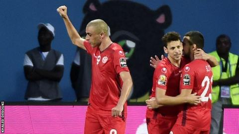 Tunisia's players celebrate after their opening goal