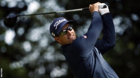Adam Scott hits a drive