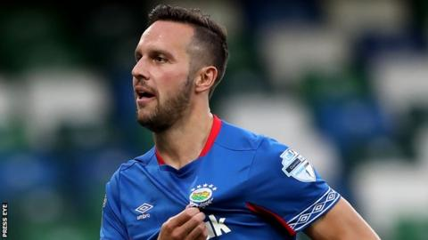 Andy Waterworth scored all three goals for Linfield in the tie