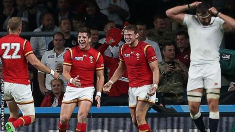 Rhys Priestland (left), Lloyd Williams and Dan Biggar celebrate Wales' win against England