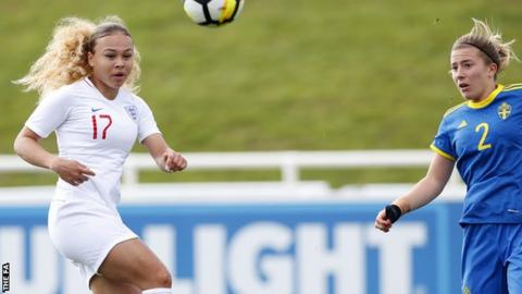 Ebony Salmon (left) in action for England Under-19s against Sweden