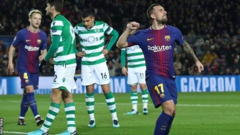 Barcelona's Paco Alcacer celebrates scoring against Sporting Lisbon