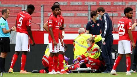 Liverpool winger Taiwo Awoniyi taken to hospital playing for Mainz against Augsburg