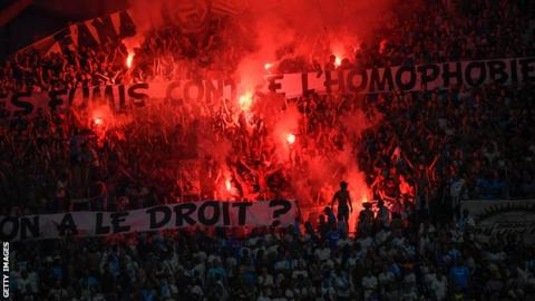 Marseille supporters hold up banners with messages against homophobia