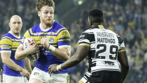 Leeds' Anthony Mullally braces for a tackle