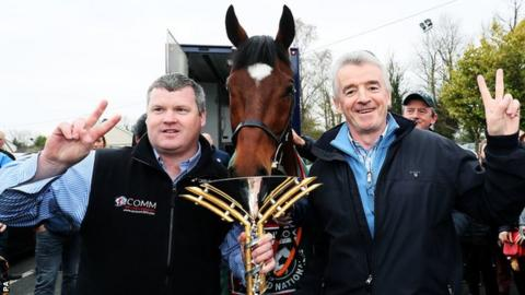 The 2019 Grand National Wwinner Tiger Roll with trainer Gordon Elliott (left) and owner Michael O'Leary