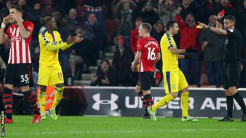 Wilfried Zaha is dismissed against Southampton