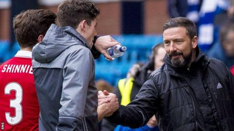 Aberdeen players are congratulated by manager Derek McInnes
