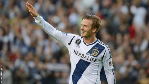 Former LA Galaxy midfielder David Beckham waves to fans after winning the 2012 MLS Cup in his final game for the club