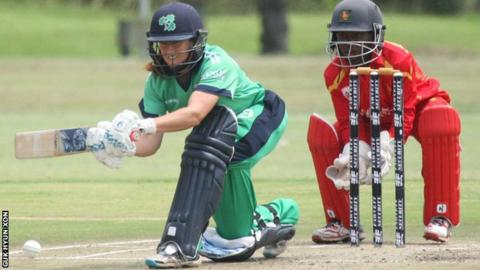 Isobel Joyce attempts a sweep shot in Ireland's innings in Harare