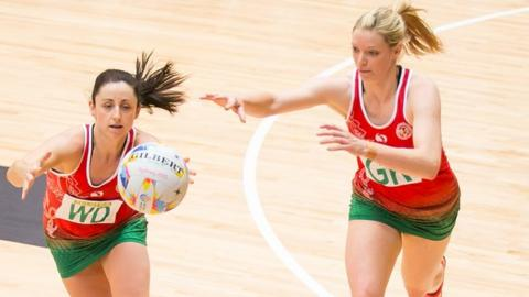 Wales captain Suzy Drane and goalkeeper Rosanna Pretorius in action against Fiji