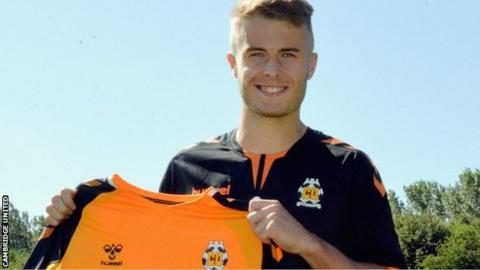 Andrew Dallas poses with a Cambridge shirt
