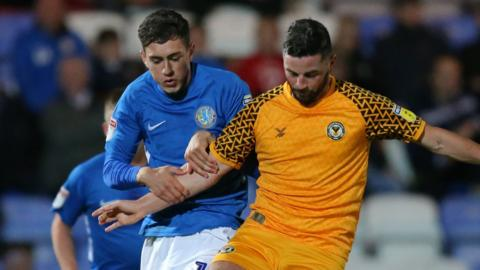 Corey O'Keefe of Macclesfield Town and Padraig Amond of Newport County