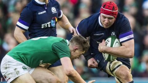 Grant Gilchrist carries ball for Scotland against Ireland