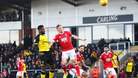 Darren Bent heads over for Burton