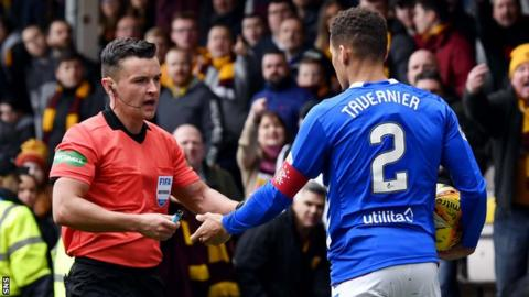 Items including a lighter, pie and coin all landed close to James Tavernier during Rangers' 3-0 win at Fir Park