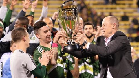 Ridgewell lifts the MLS Cup with Portland Timbers owner Merritt Paulson in 2015