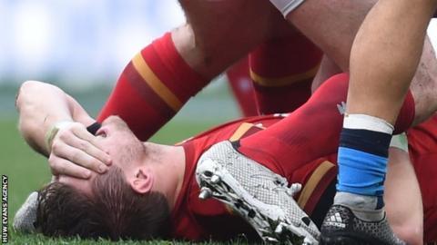 Dan Biggar holds his head as he feels the pain of injury