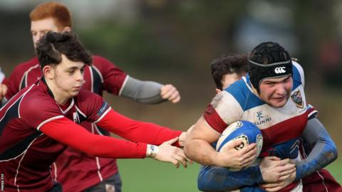 Dalriada's Denis Posternak makes a break during his side's second round 48-3 win away to Larne Grammar