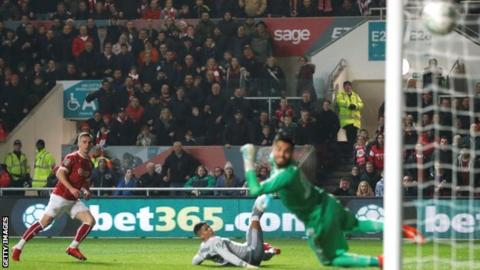 Joe Bryan scores Bristol City's opening goal against Manchester United