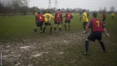 Local amateur football is played on a muddy football pitch at Hackney Marshes