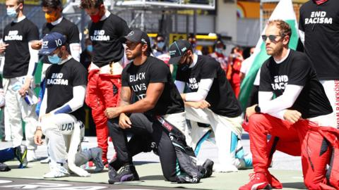 Lewis Hamilton (centre) takes a knee before Austrian Grand Prix