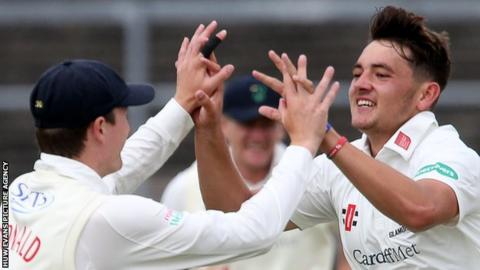 Lukas Carey (right) celebrates the key wicket of Northamptonshire's Ben Duckett with Aneurin Donald