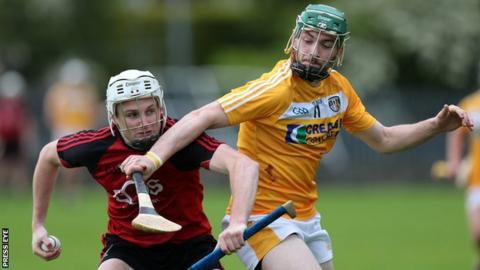 Down's Conor Mageean and Conor McCann of Antrim in action at Cushendall